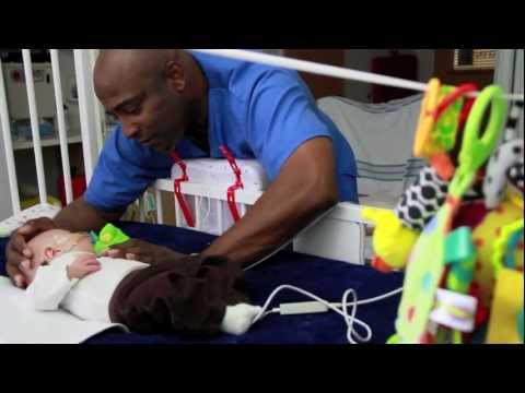 Making Holidays in the Hospital Brighter: PICU Nurse Chester Sings to Premature Baby