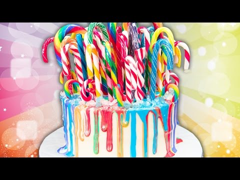 Rainbow Drip Candy Cane Cake  (Christmas Cake) from Cookies Cupcakes and Cardio