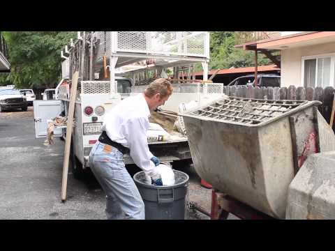 Mix stucco or cement plaster in a mortar or stucco mixer