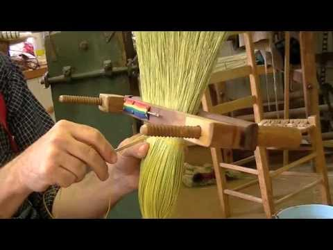 Stitching a broom in a hand clamp