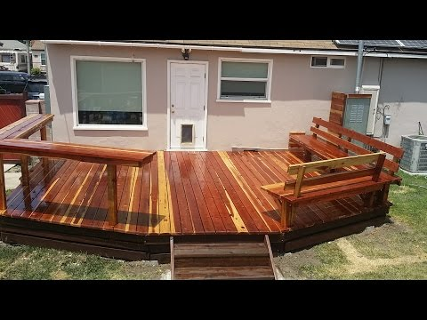 Redwood deck with built-in benches and bar