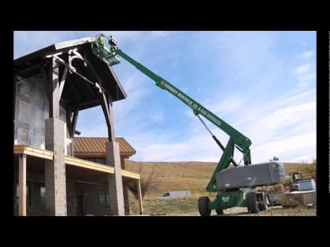 Staining a Timber frame home in Big Horn, Wyoming