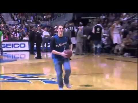 Boy shows off for his girlfriend in basketball stadium