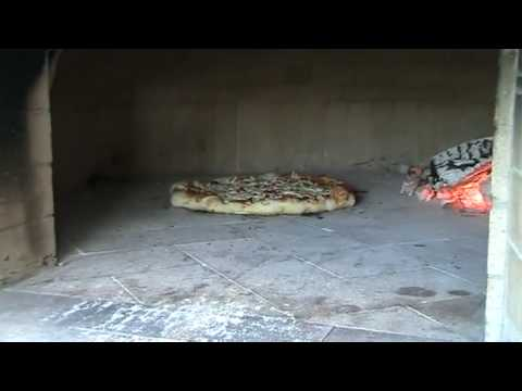 Pizza Baking in a Pompeii Italian Oven
