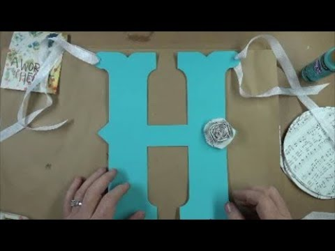 Painted Chipboard Letter Banner with Paper Rosettes
