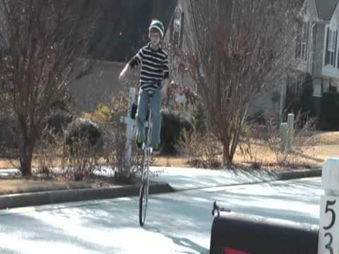 Jay Thomas rides tall unicycle