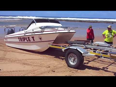 How to load a ski boat onto a trailer on the beach. Cape Vidal