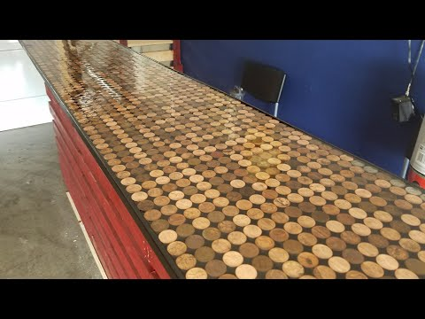 Putting the Epoxy coat on our penny bar top