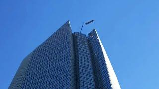 Men Caught In High Winds on Skyscraper