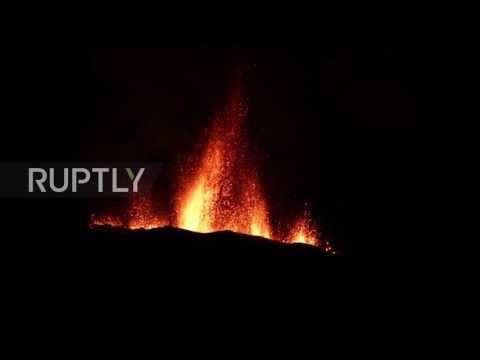 France: Piton de la Fournaise volcano spews lava into night sky