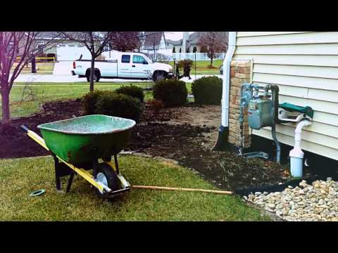 Lawn Pro Plus--- Landscaping/Flower beds with river rock