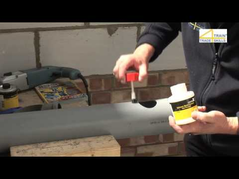 Attaching a boss strap to a soil pipe
