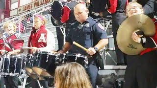 Arkansas Cop Shocks Crowd When He Drums With High School Football Band