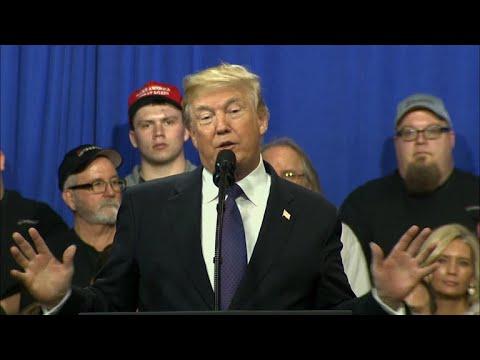 Trump touts tax bill as stocks plummet