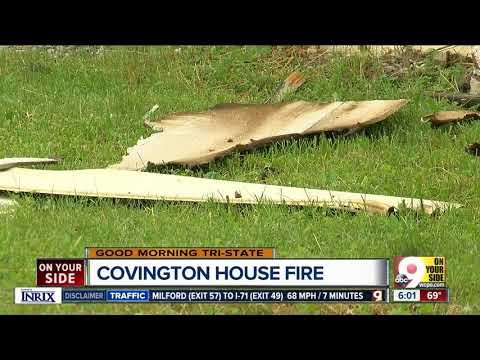 Woman, dogs escape house fire in Covington