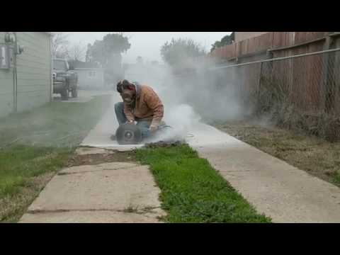 footage: Cutting Concrete sidewalk with angle Grinder & 14