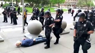 WARNING: GRAPHIC CONTENT - Video shows police in Buffalo, New York, shoving man to ground