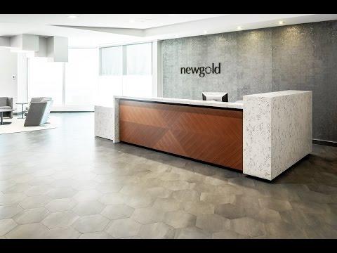 Custom White Quartz Corporate Office Reception Desk | New Gold Inc. | ASTOUND Group