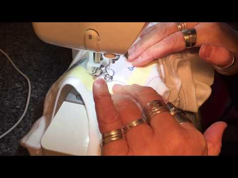 Freemotion sewing on a baby onesie vest
