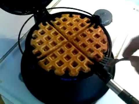 Making waffles on an antique waffle iron