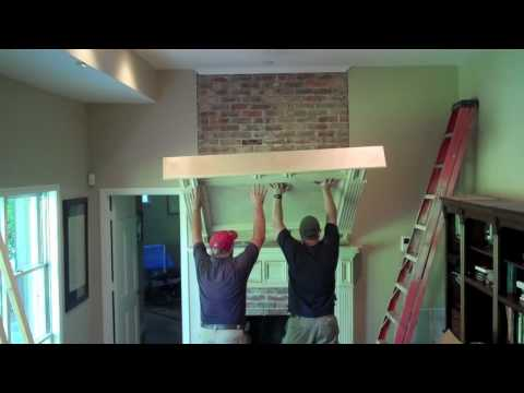 Brick floor to ceiling fireplace makeover