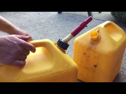 Changing the spout on a fuel can.