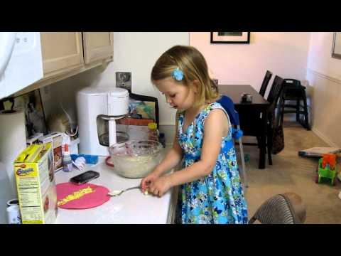 Emma making bunny bread
