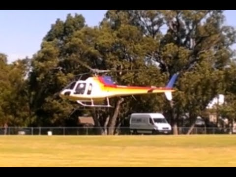 Perth Hills bushfire - Air Support Squirrel helicopter landing at Glen Forrest Oval to refuel