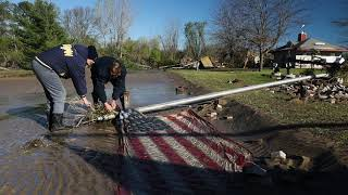 American flag pulled from mud after Michigan flood