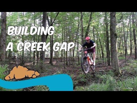 Building a creek gap! | MTB trail building