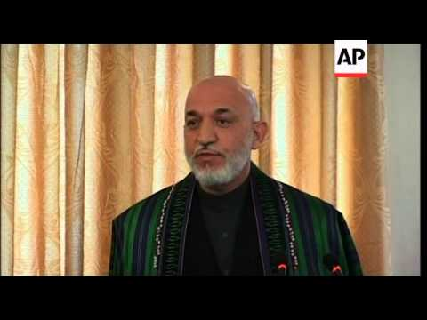 Afghan president says Iran - and US - give bags of money to help its office