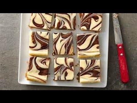 THE BEST CHEESECAKE BARS W/ SWIRLED HAZELNUT SPREAD (CHOCOLATE CHIP COOKIE CRUST)