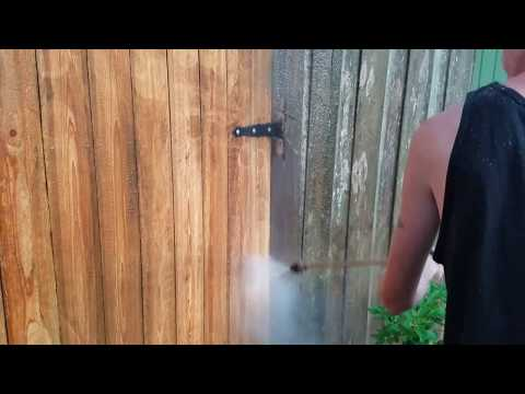 Cleaning a dirty fence pressure washing