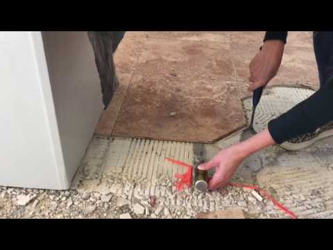 How to remove tile, mortar and lathe from a subfloor
