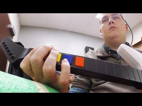 Scientists Help A Paralyzed Man Play 'Guitar Hero' - Newsy