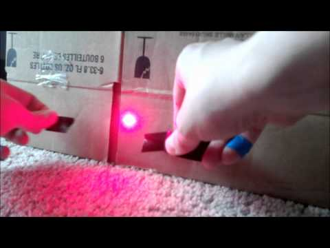 Home made 650nm laser diode at 200mw burning tape, match heads and popping balloon