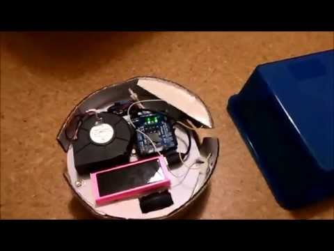Robot vacuum cleaner from cardboard controlled by Arduino