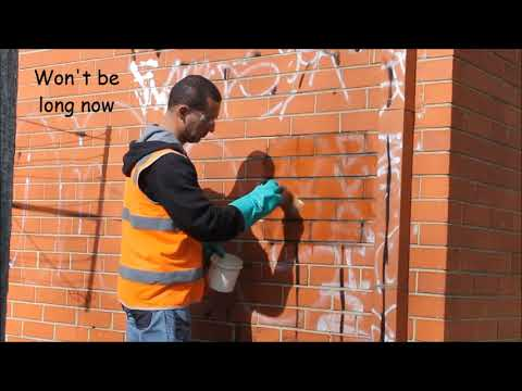 Removal of old sunbaked graffiti from Brick
