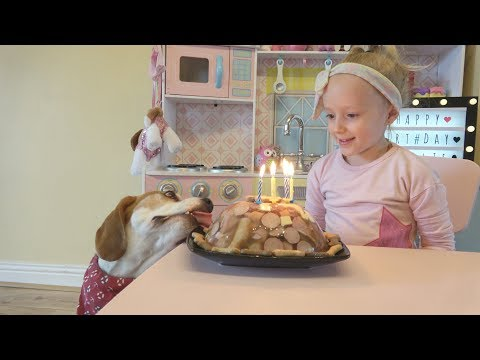 Charlie the Dog Surprised by Birthday Cake and Toys from Little Girl