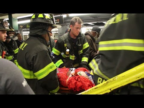 FDNY rescues man under train in Brooklyn