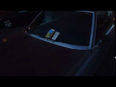 A car with a ticket and a pack of condoms on the windshield in Calgary