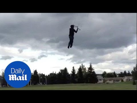 Man lift by heavy winds when trying to fly kite - Daily Mail