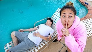 I PUSHED MY BROTHER INTO THE POOL!!