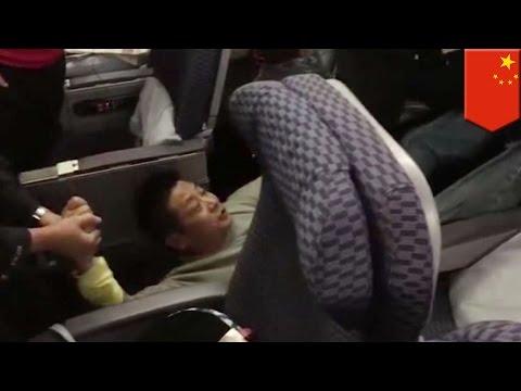 Badly behaved Chinese plane passenger throws temper tantrum on flight for upgrade - TomoNews
