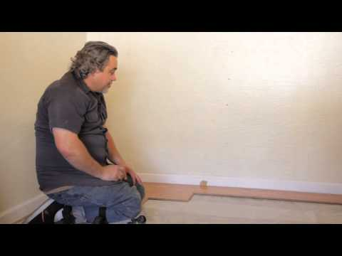 How to Keep Spacers From Moving When Installing Lamina... : Laminate Flooring Installation & Repair