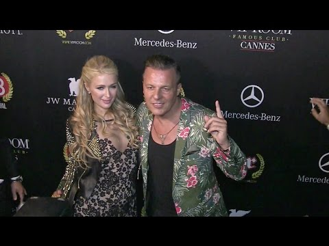 Paris Hilton is welcomed by Jean Roch at VIP Room in Cannes