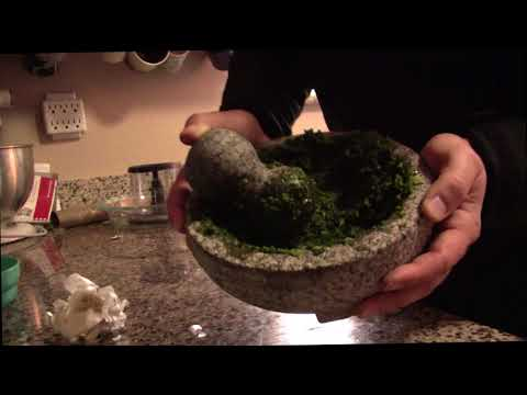 Makes pesto, with a mortar and pestle