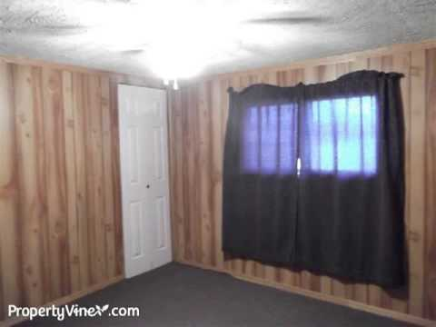 Mobile home with additions on .62 acres