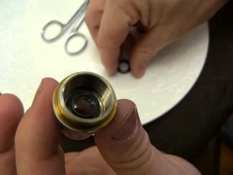 Microscope lens cleaning
