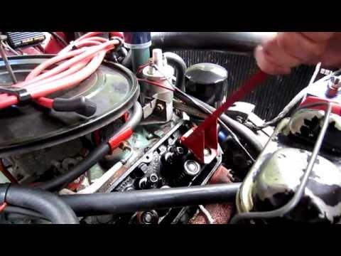 Replacing valve stem oil seals on AMC V8 with nylon rope method.